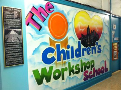 the children's workshop school written in graffiti on a school wall
