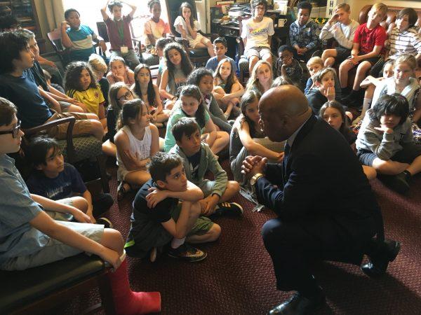 cws fifth graders sitting meeting wtih representative john lewis on their trip to washington dc